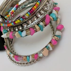 bebe 9 pc bracelets.. Multicolored.NWT